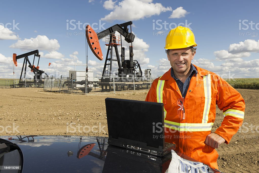 Oil Pump and Computer royalty-free stock photo