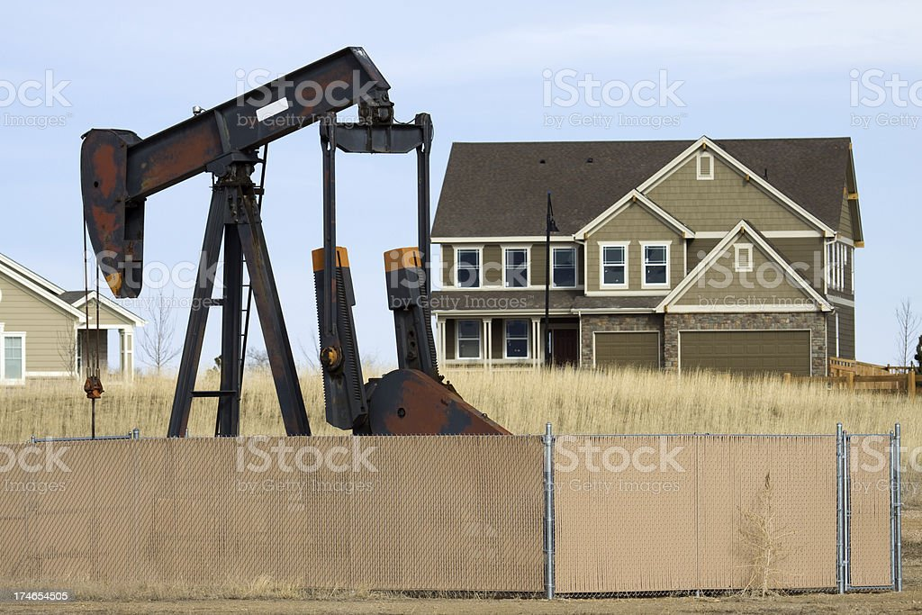 Oil Pump and Home Frederick Colorado stock photo