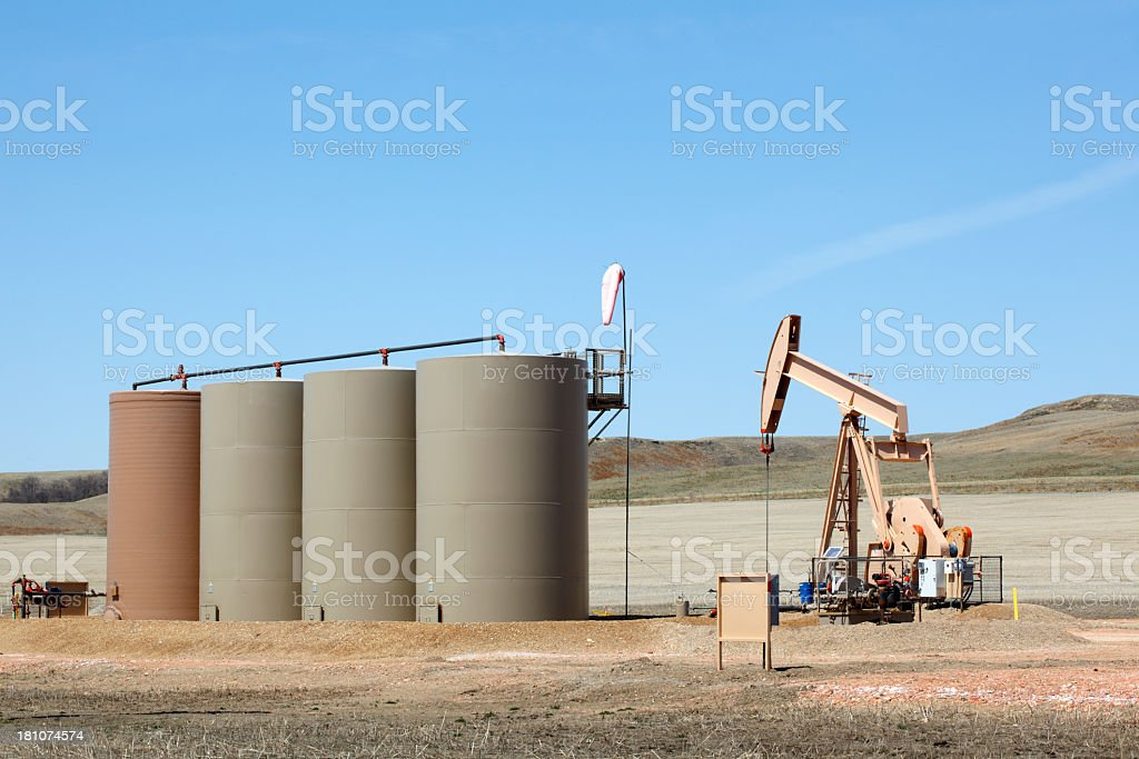 Oil pump and storage tanks near Williston, ND stock photo