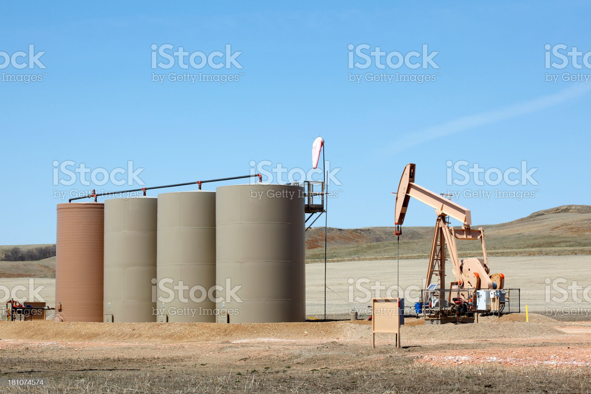 Oil pump and storage tanks near Williston, ND royalty-free stock photo