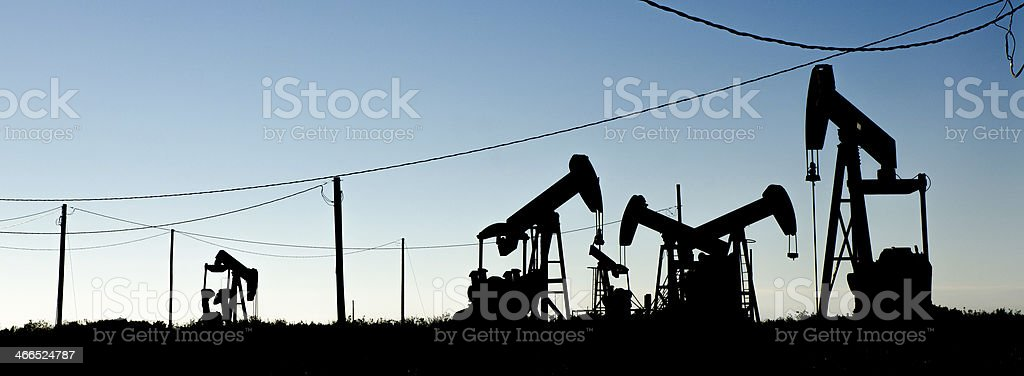 Oil Pump at sunset during blue hour stock photo