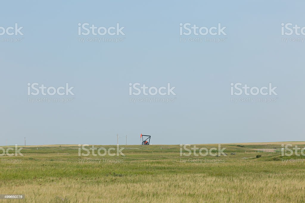 oil pump jack in open countryside stock photo