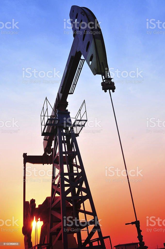 Oil Pump on orange sunset stock photo