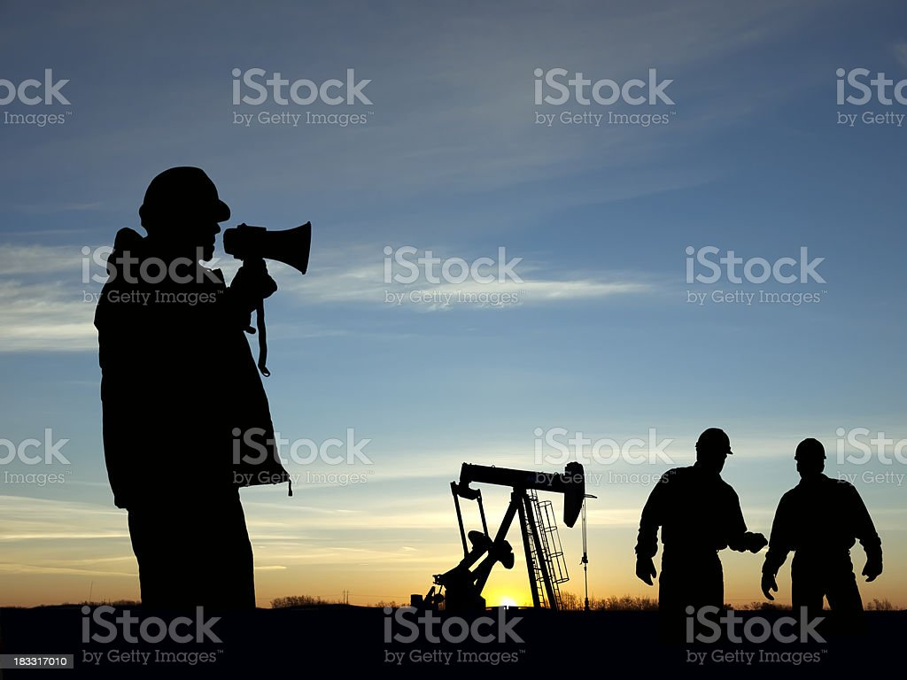 Oil Pump Pumpjack & Alert For Three Workers royalty-free stock photo