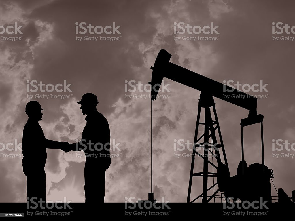 Oil Pump Pumpjack & Worker Silhouettes royalty-free stock photo