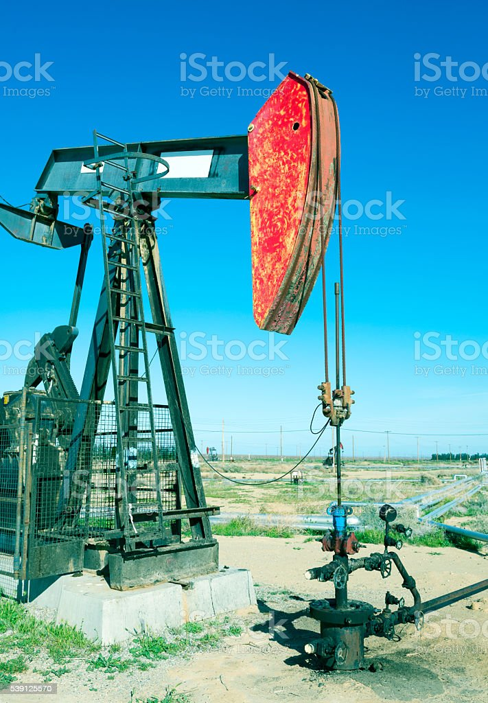 Oil pump working field in central California stock photo