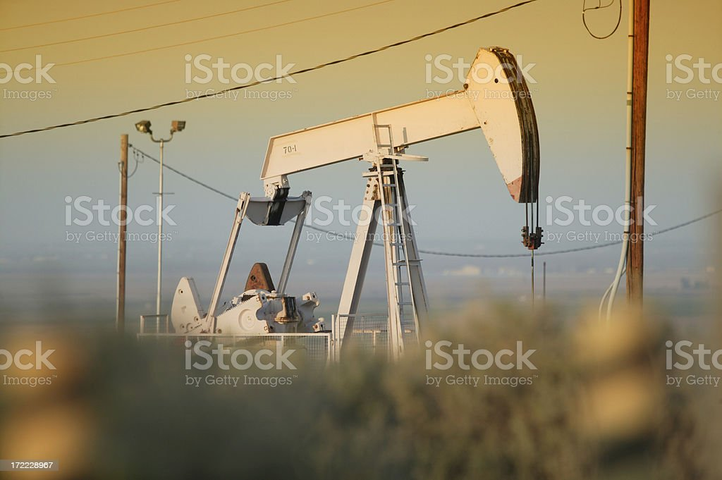Oil pumper at sunset royalty-free stock photo