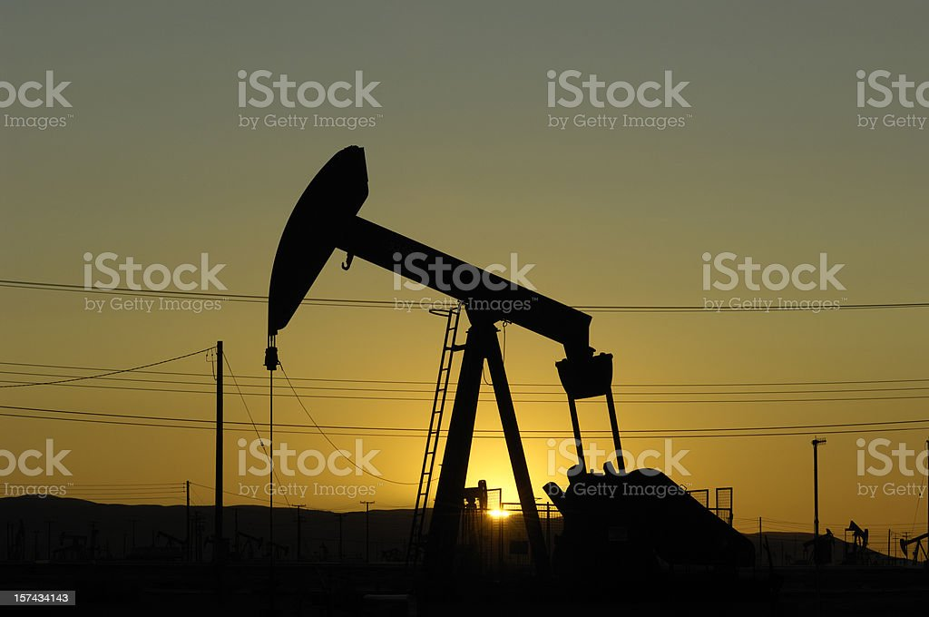 Oil Pumpjack Against a Sunset Sky royalty-free stock photo