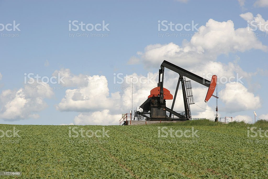 Oil PumpJack And Agriculture Landscape royalty-free stock photo