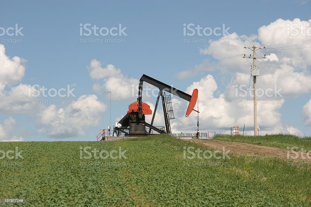 Oil Pumpjack And Agriculture Together royalty-free stock photo