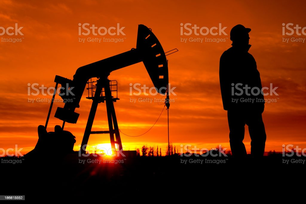 Oil Pumpjack and Worker stock photo