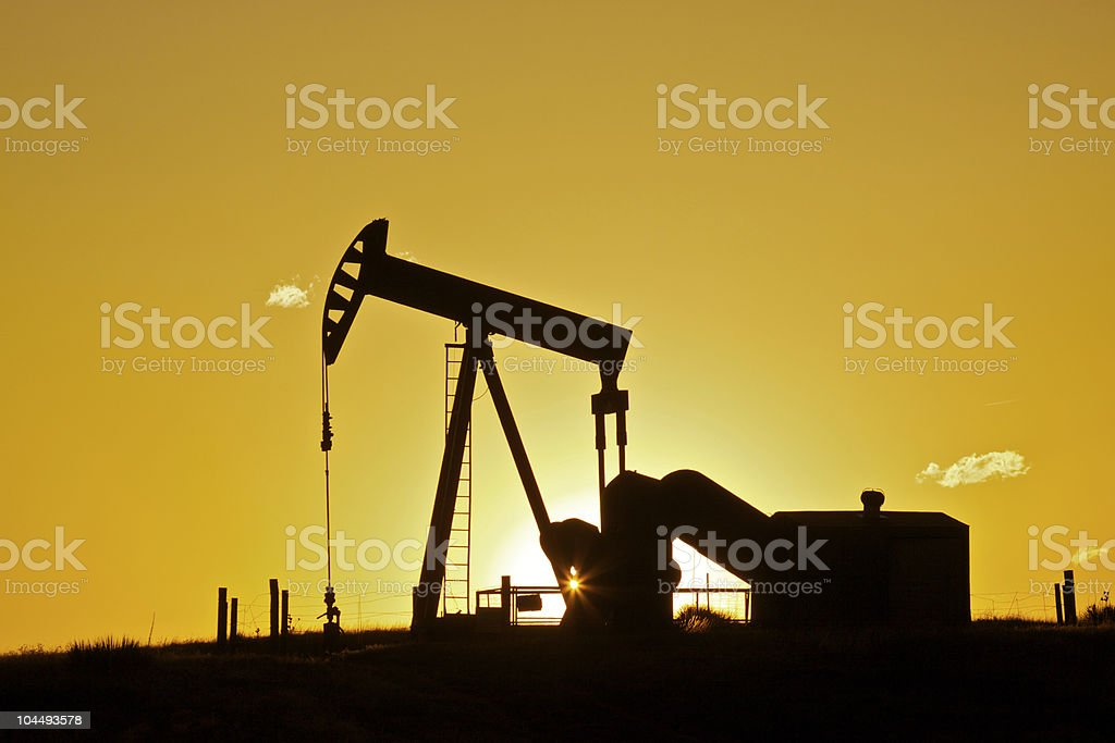Oil Pumpjack in Sunset royalty-free stock photo