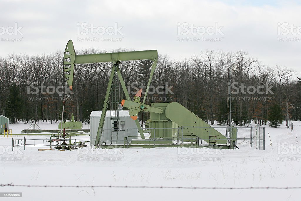 Oil Pumpjack in the snow royalty-free stock photo