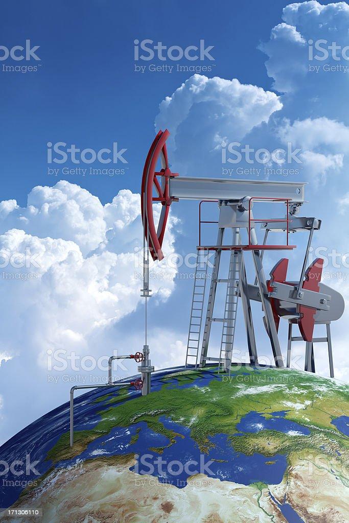 Oil pumpjack on Earth globe royalty-free stock photo