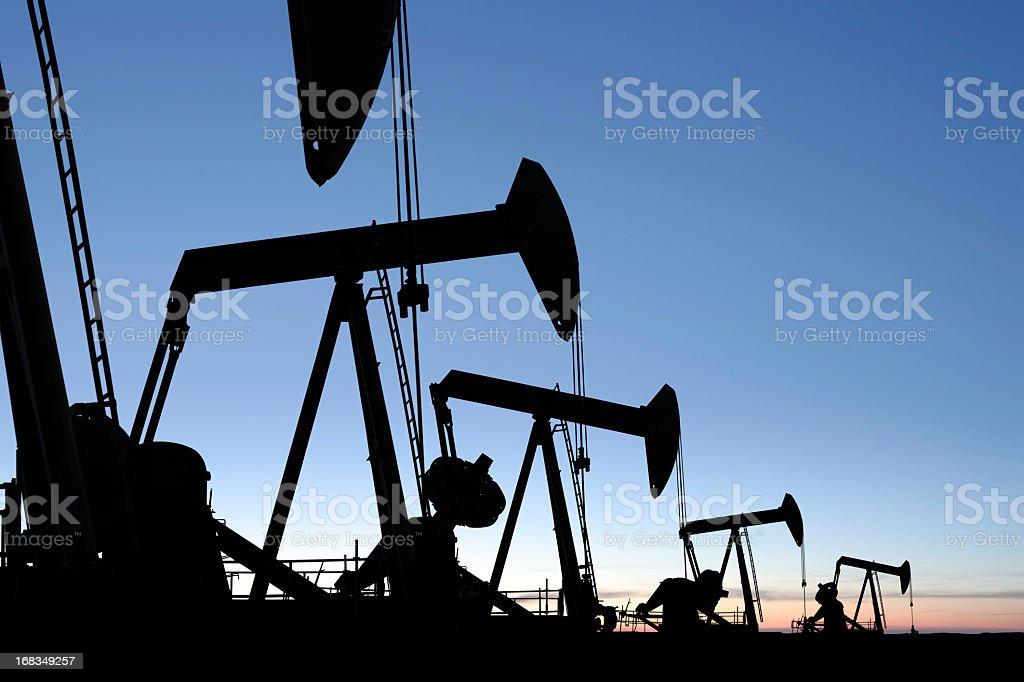 XXXL oil pumpjack silhouettes stock photo