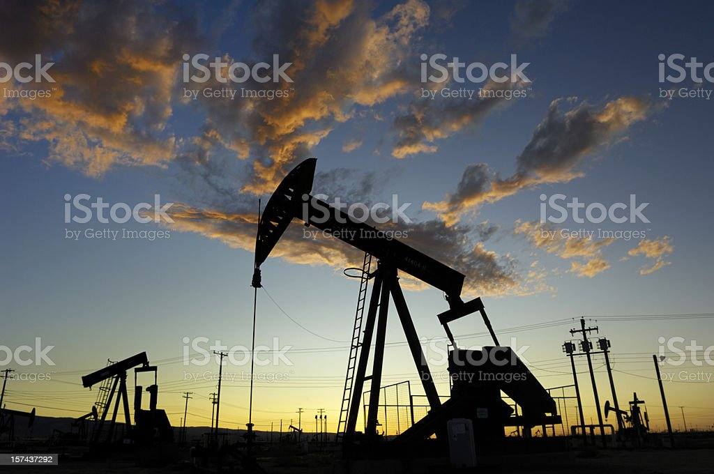 Oil Pumpjacks Against a Sunset Sky royalty-free stock photo