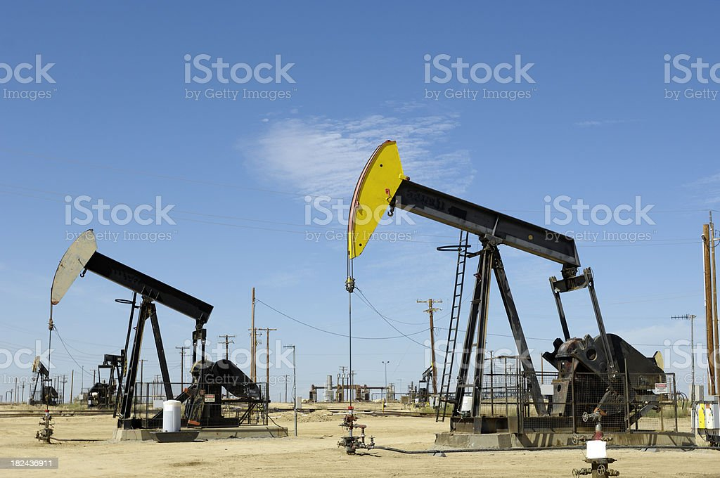 Oil Pumpjacks with Others in Background royalty-free stock photo