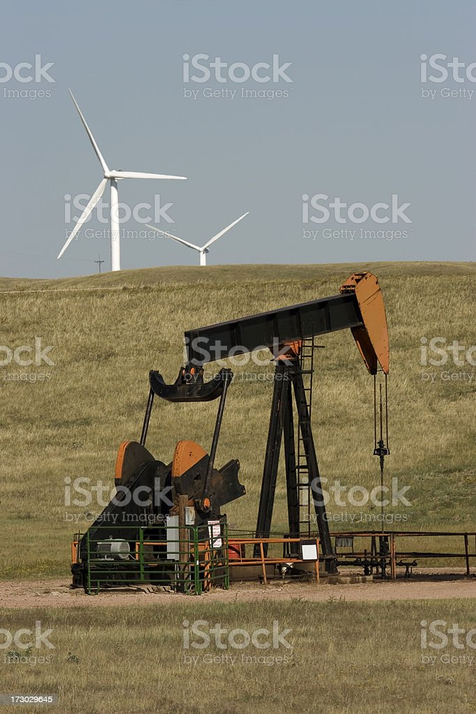 Oil pumps and wind turbines royalty-free stock photo