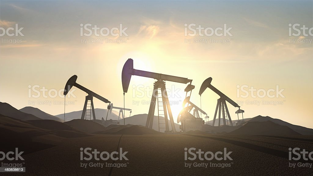Oil pumps at sunrise stock photo