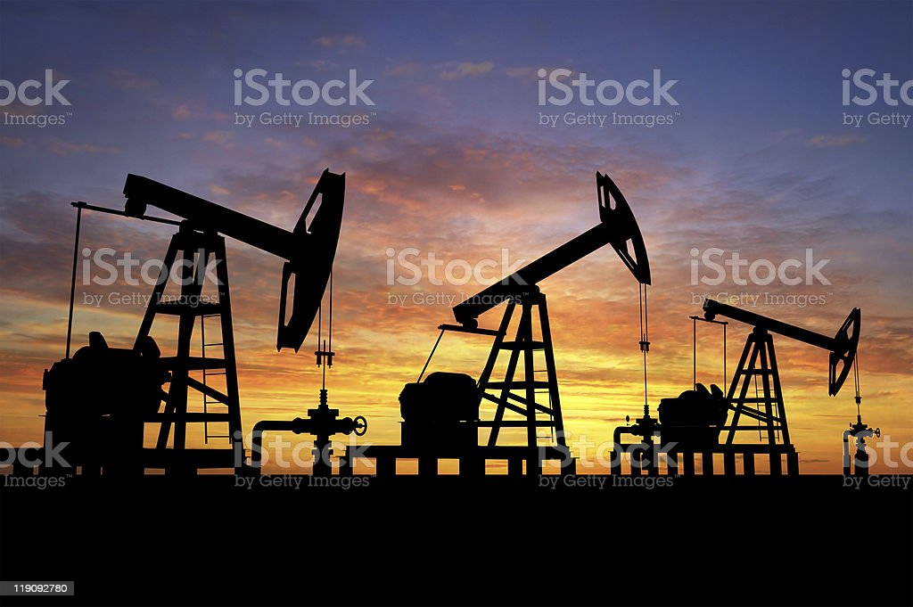 Oil pumps at sunset stock photo
