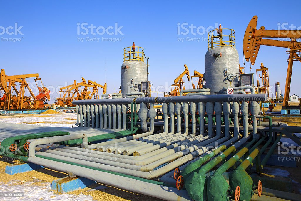 Oil pumps in gray and green colors royalty-free stock photo