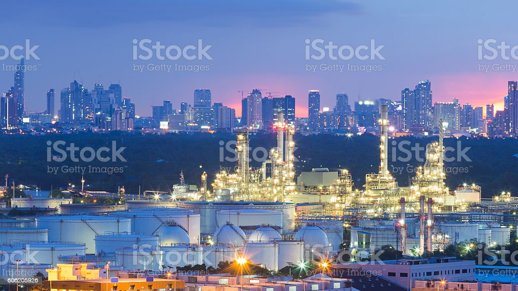 Oil refinery and Tank with city downtown stock photo