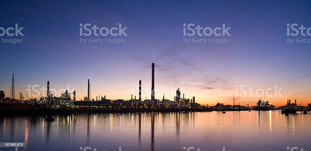 Oil refinery at dusk royalty-free stock photo