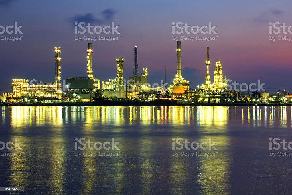 Oil refinery at sunrise in morning royalty-free stock photo