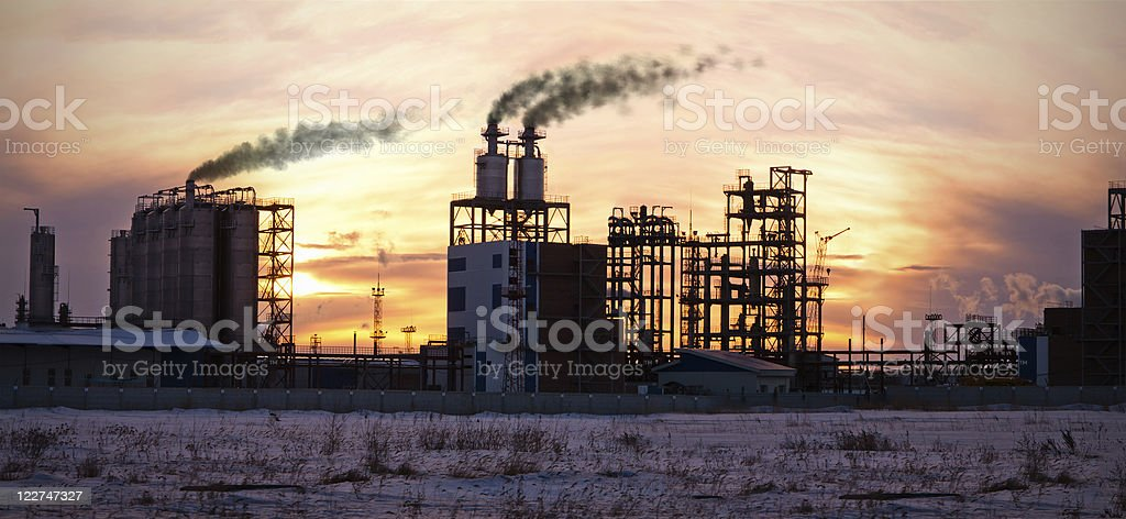 Oil refinery at sunset. Enviroment pollution. royalty-free stock photo