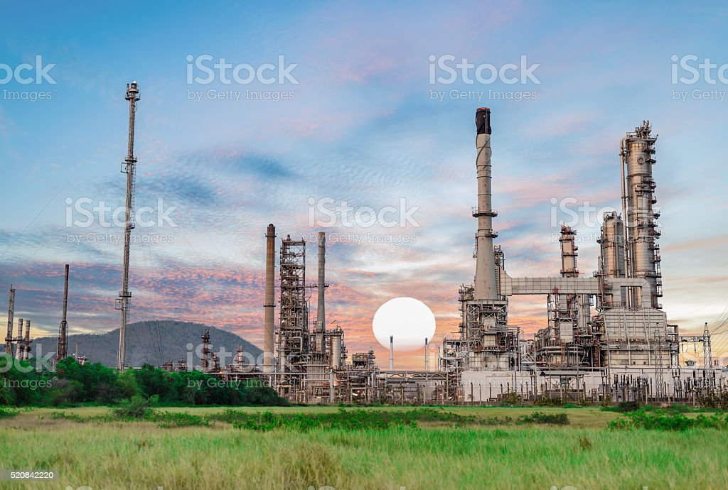 Oil refinery at twilight, Petrochemical plant, factory Oil refinery stock photo