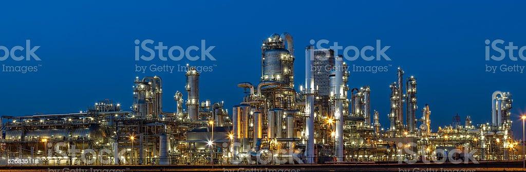 Oil Refinery Illuminated at Dusk stock photo