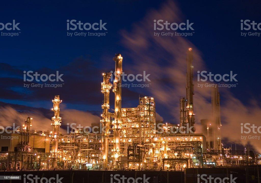 Oil Refinery Illuminated at Night stock photo