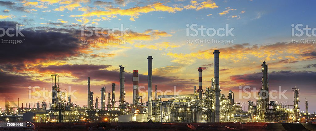 Oil refinery industrial plant at night stock photo
