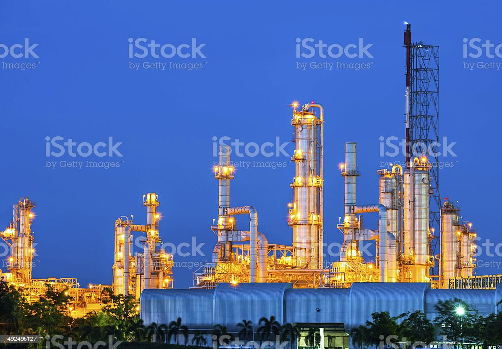 Oil refinery plant at night sky stock photo