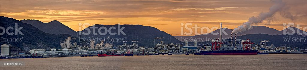 Oil refinery plant at sunset stock photo
