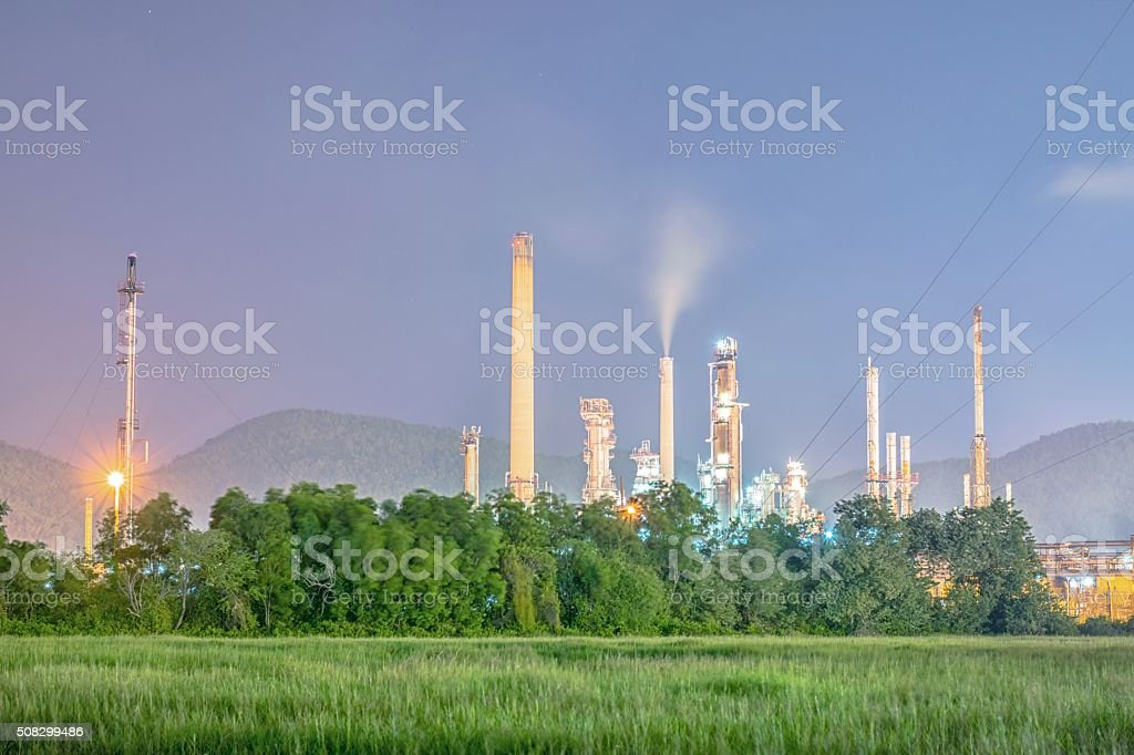 Oil refinery plant at twilight - petrochemical plant stock photo