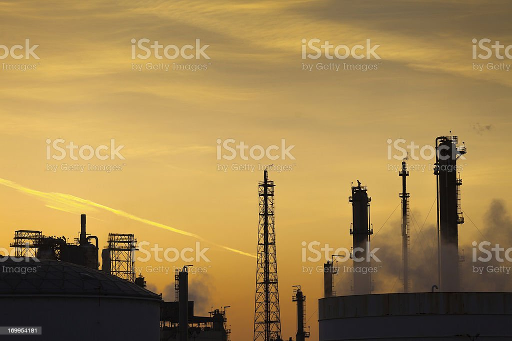 Oil Refinery Silhouette at Sunset royalty-free stock photo
