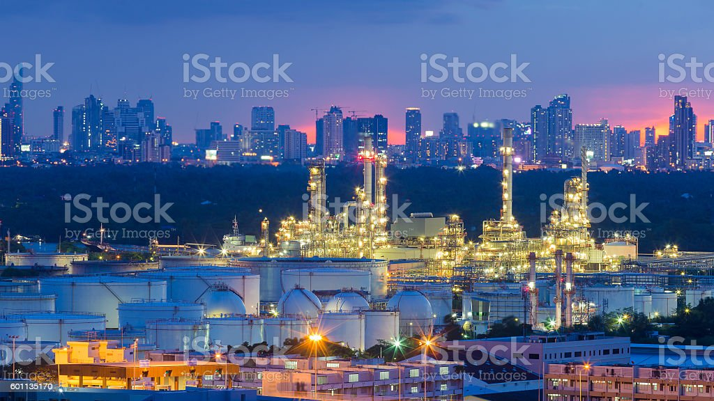 Oil refinery tank and factory with city downtown stock photo
