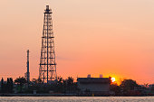 Oil refinery tower during sunrise