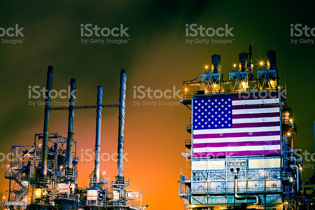 Oil Refinery with American Flag at Night stock photo