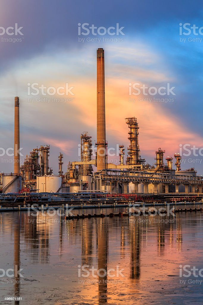 Oil refinery with reflection on the water royalty-free stock photo