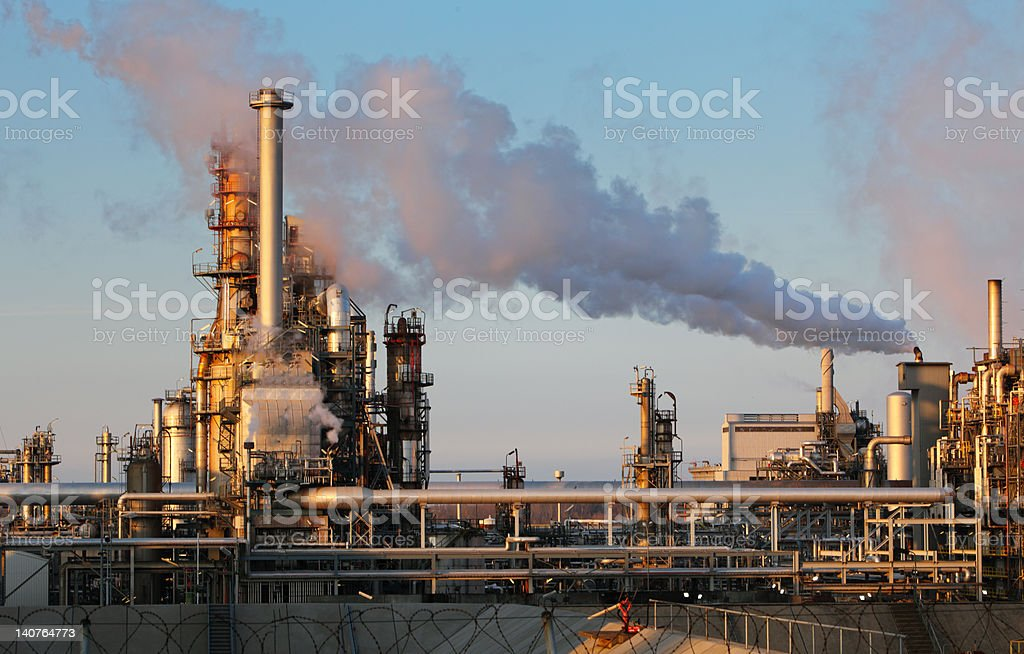 Oil refinery with smokestack royalty-free stock photo