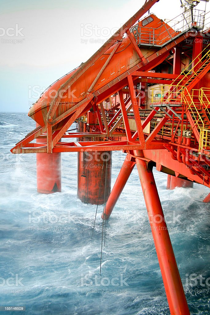 oil rig and lifeboat at sea royalty-free stock photo