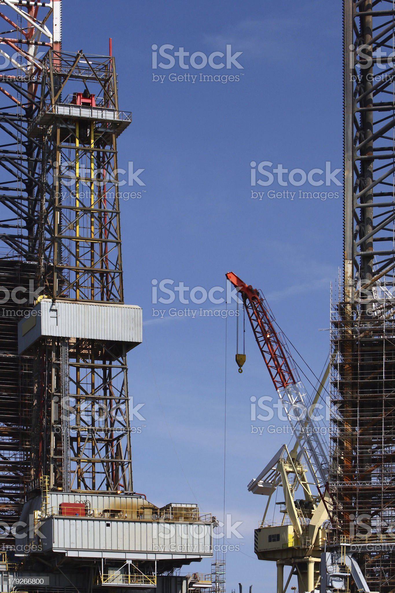 Oil Rig and red crane royalty-free stock photo