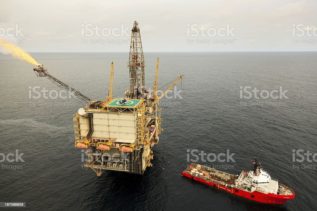 Oil Rig and Supply Ship stock photo