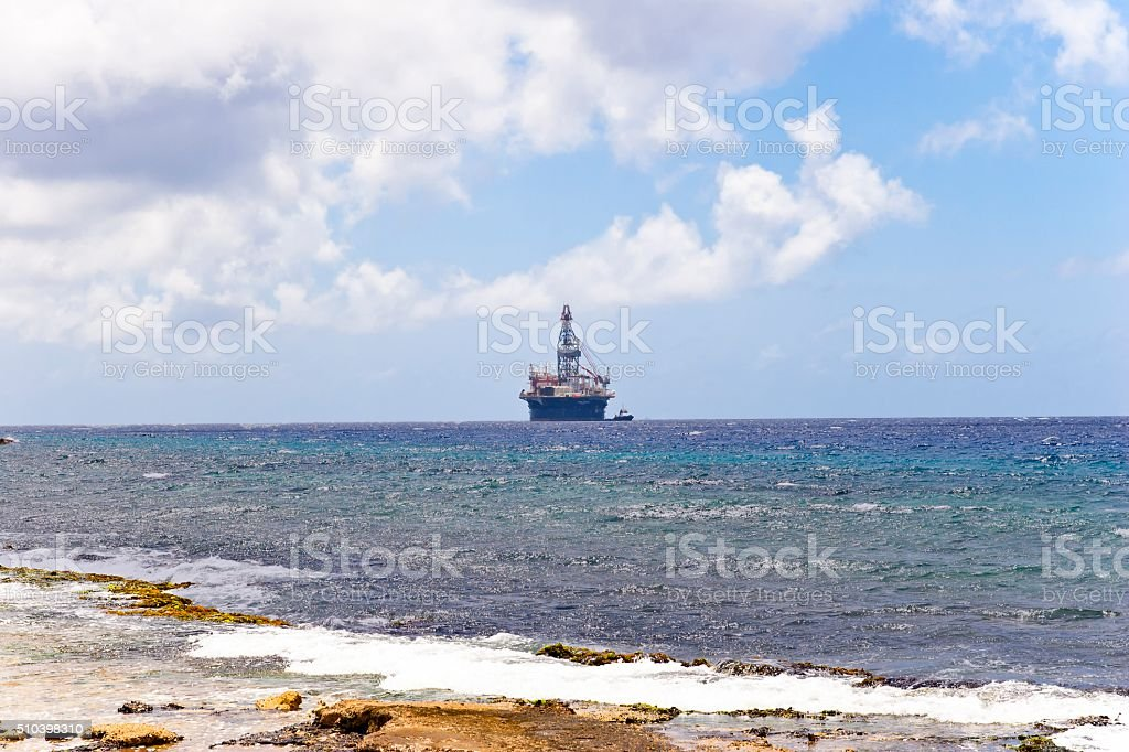Oil Rig and Tug Boat in the Caribbean stock photo