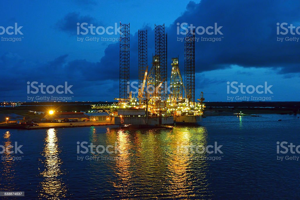 Oil rig at dusk stock photo