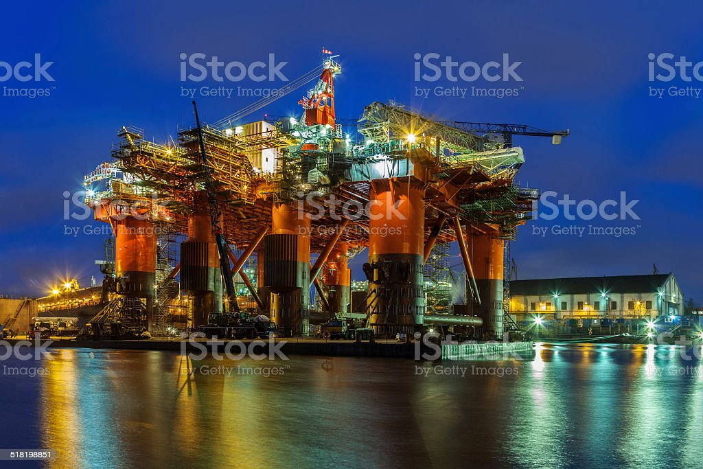 Oil Rig at night stock photo