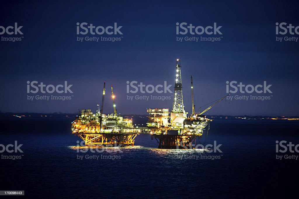 Oil Rig at Sunrise stock photo
