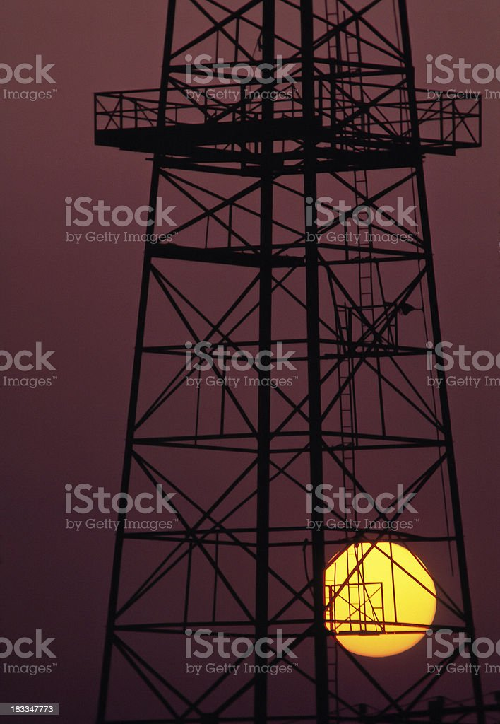Oil rig at sunset royalty-free stock photo